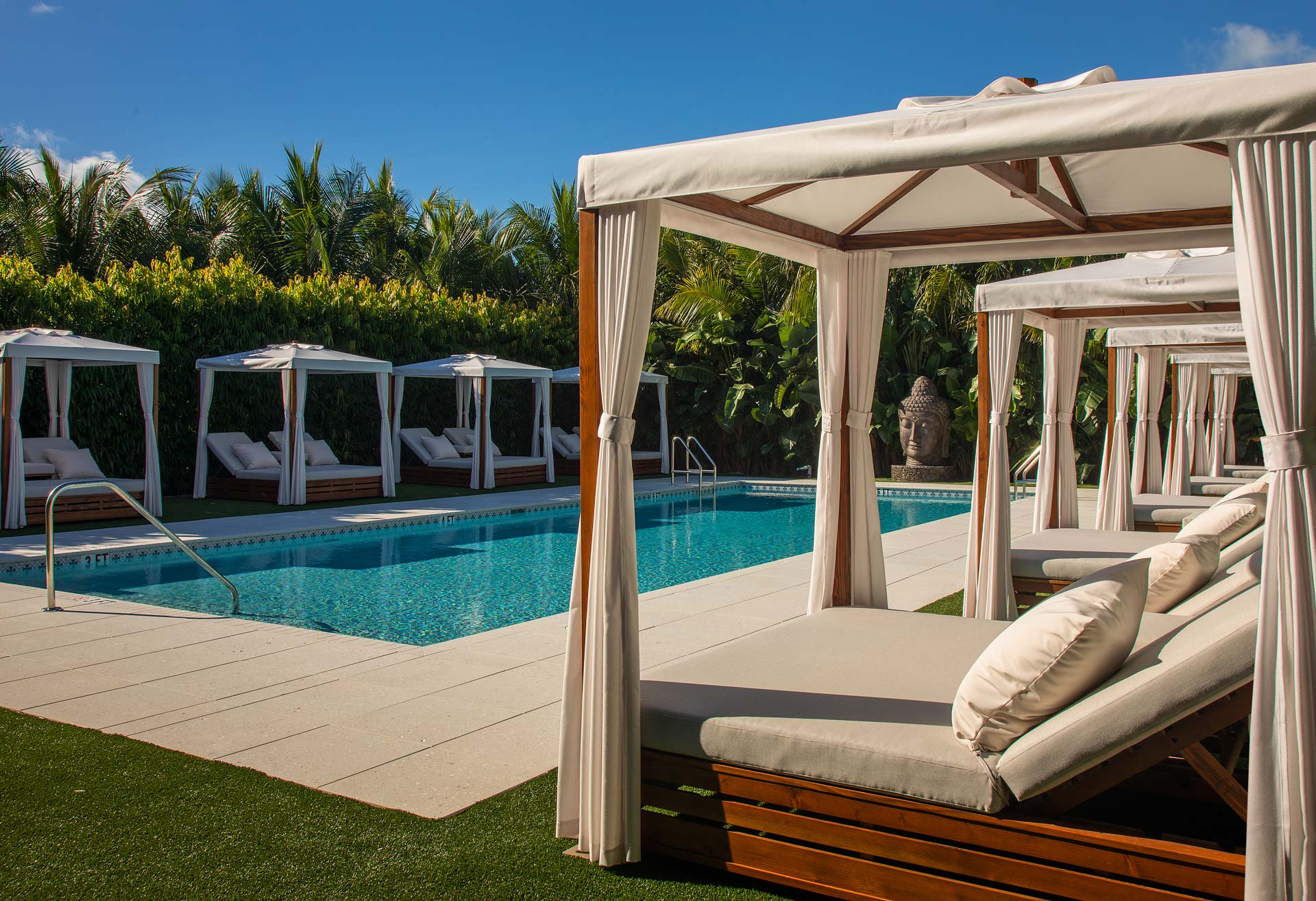 pool with eight cabana lounges surrounding it