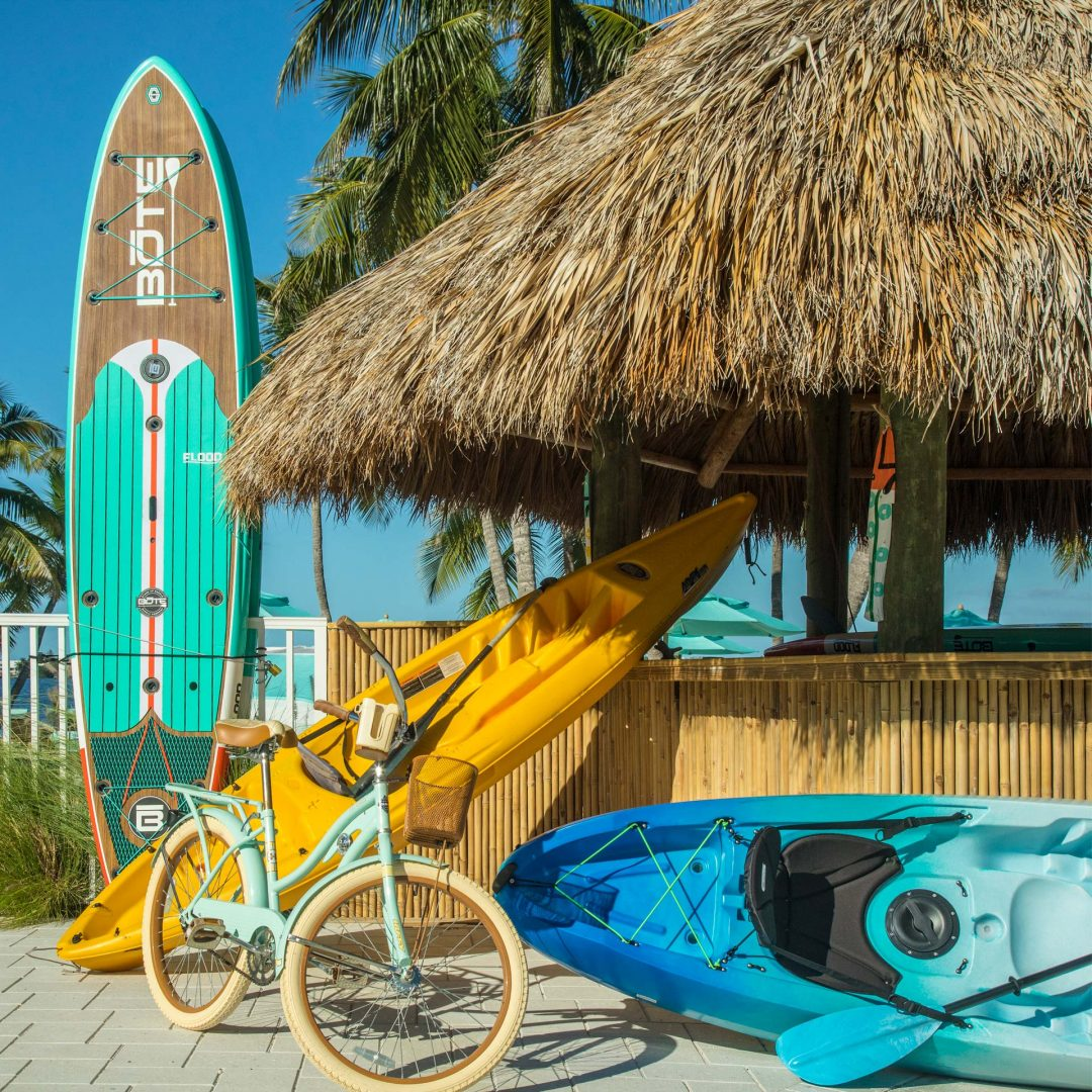 paddleboards, kayaks and a bicycle