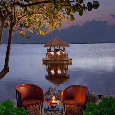 floating tiki bar at night in the water