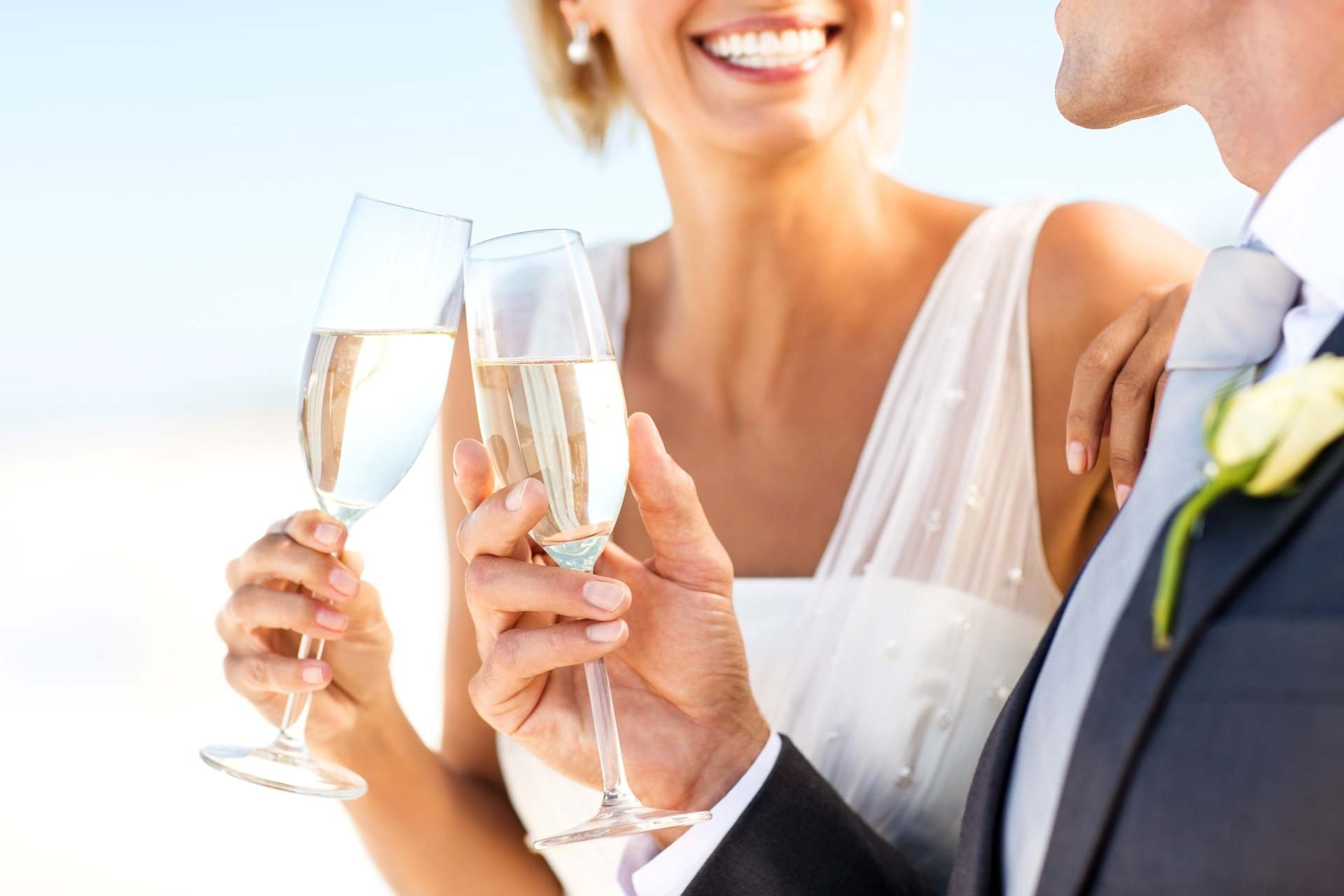 bride and groom drinking champagne together