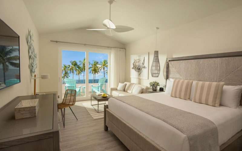 interview view of beach front bungalow with king bed