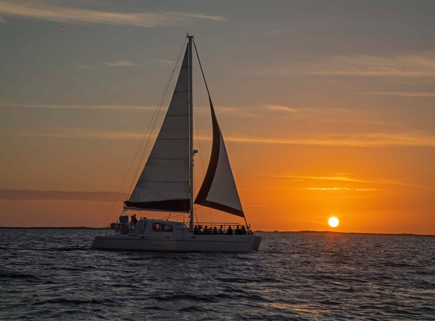Lady B sailboat out on the open water at sunset