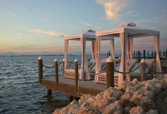 two cabanas on a dock facing the water